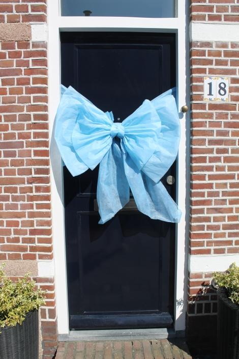 Blauwe deurstrik